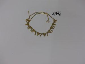 1 collier draperie en or à motifs filigranés (L44cm). PB 20,5g