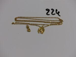1 chaîne maille plate (L58cm) et 2 pendentifs (1 main et 1 fer à cheval). Le tout en or PB 6,1g