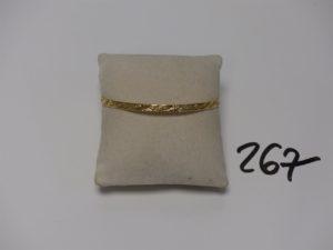 1 bracelet rigide ouvragé en or (diamètre 6,5cm). PB 9g