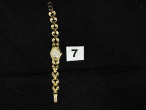 1 Montre dame en or ESKA à bracelet articulé (L 15cm) en etat de fonctionnement . PB 24,3g