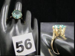 1 Bague en alliage 585/1000 ( 14k) ornée d'une pierre vert clair (TD 59). PB 4,2g
