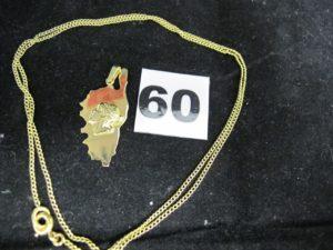 1 Pendentif plaque representant la corseet 1 chaine maille gourmette (L 54cm). Le tout en or. PB 5,8g