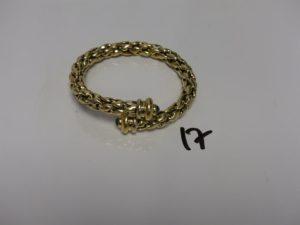 1 bracelet en or, maille tressée montée sur ressort et orné de 2 petites pierres cabochons (diamètre 6/6,5cm). PB 33g