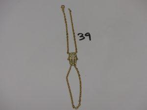 1 bracelet doigt en or motif central à décor d'une main ornée de pierres (L19cm). PB 11,8g