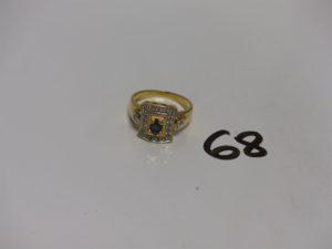 1 bague en or ornée d'une pierre bleue et de petits diamants (td59). PB 7,6g