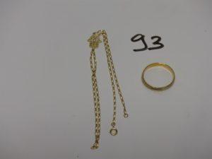 1 alliance bicolore en or (Td61) et 1 bracelet de doigt en or motif central à décor d'une main (L17cm). PB 5,8g