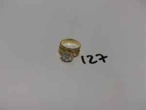 1 bague en or ornée de pierres (Td57). PB 6,5g