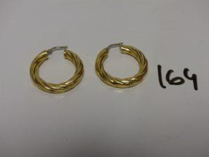 2 créoles torsadées en or (un peu cabossée). PB 5,4g