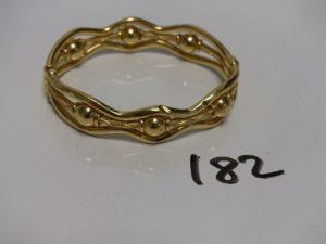 1 bracelet ouvrant en or articulé et ouvragé (diam 5/6cm). PB 19,5g