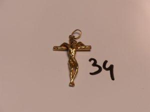 1 Christ sur croix en or (H4,5cm). PB 9,3g