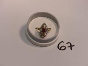 1 bague marquise en or ornée d'une pierre rouge entourage pierres blanches (Td54). PB 5,2g