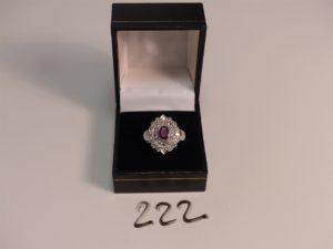 1 bague en or ornée d'un rubis ovale dans un double entourage de diamants (Td56). PB 8,9g