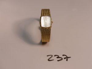 1 montre bracelet dame Omega quartz en métal doré
