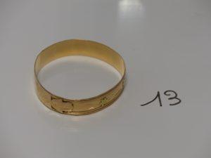 1 bracelet rigide ouvragé en or (diamètre 6,5cm). PB 28,6g