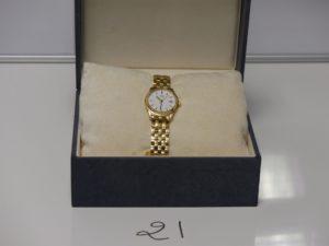1 montre dame de marque SEIKO bracelet et boitier or (ref.7N82-0231/11013150). PB 48,5g