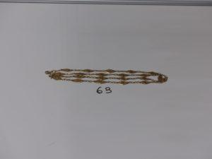 1 collier en or à motifs filigranés (L74cm). PB 15,3g