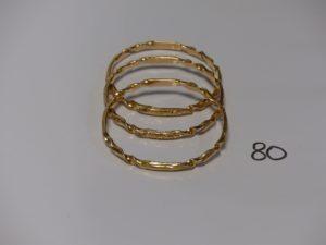 3 bracelets rigides ouvragés en or (dimaètre 6,5cm). PB 75g