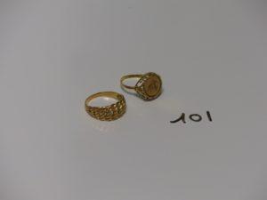 2 bagues en or(1 ouvragée td59 et 1 motif central maille américaine td63). PB 7,6g