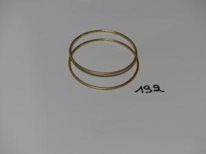 2 bracelets joncs en or (diamaètre 6cm). PB 18,8g