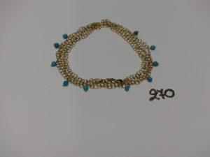 1 collier en or à 2 rangs de chaînes ornées de petites perles turquoises en pampille (L44cm). PB 8g