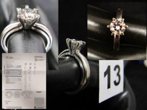 1 Bague solitaire en or gris sertie d'un diamant taille moderne de 1 carat G/S1 avec certificat GIA (TD 49). PB 4,9g