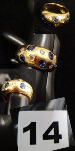 1 bague boule en or jaune sertie de 5 saphirs et 5 diamants ( TD 60). PB 13,7g