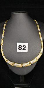 1 Collier en or bicolore style peau de serpent articulé, gradué (L 49cm). PB 21,2g