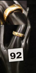 1 Bague en or striée de petits diamants (TD 61). PB 4,3g