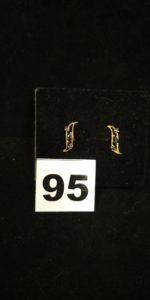 2 boucles d'oreilles en or réhaussées depierres bleues . PB 0,9g