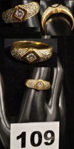 1 Bague en or ornée de diamants (TD 57). PB 7,4g