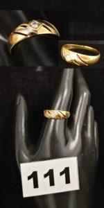 1 Bague en or bicolore ajourée ornée d' un diamant (TD 61). PB 2,4g
