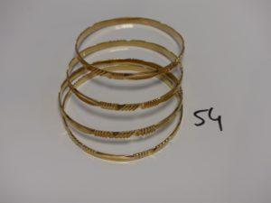 4 bracelets rigides ciselés en or (diamètre 7cm). PB 60,2g