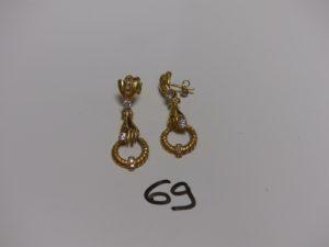 2 pendants en or à décor d'une main ornée de petites pierres (1 système en métal). PB 6,5g