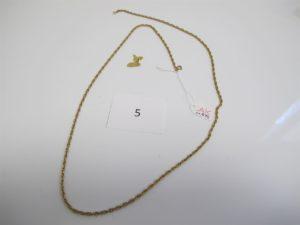 1 Collier alliage 14 K maille corde (L76cm), 1 pendentif en or à décor de lacarte de la Guadeloupe. PB or et alliage14 k 12,43 g(alliage 14 k 11,50g+0,80g or).