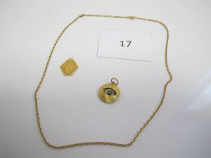 1 Chaine en or maille forçat(L47cm),1 médaille de la vierge en or,1 pendentif en or à décor d'oeil.PB 9,7g.