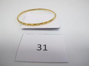 1 Bracelet en or rigide ciselé(D6,6cm). PB 12g.