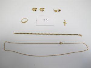 1 Chaine en or(L22cm),1 bracelet en or maille corde(L19cm),1 bague en or ornée de petites pierres(TD52),2 boucles d'oreille en or ornées de petites pierres,2 dormeuses en or ornées d'une pierre blanche,1 croix en or.PB 11,8g.