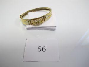 1 Bracelet en or ouvrant avec motif central orné de pierres blanches(D6cm). PB 13,1g.