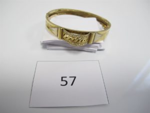 1 Bracelet en or ouvrant avec motif central orné de pierres blanches dont 2 manquantes(D6cm).PB 11,3g.