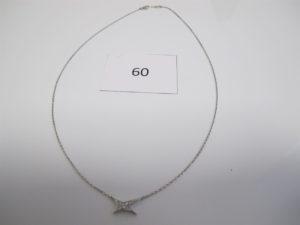 1 Collier en or gris orné de diamants à décor d'étoiles(L46cm) signé MAUBOUSSIN.PB 4 g.