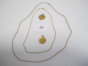 """1 Chaine en or maille forçat(L66cm), 1 chaine en or maille gourmette(L44cm),1 médaille en or à décor de la vierge,1 médaille en or ouvragée gravée""""M"""" au dos.PB 20,4g."""