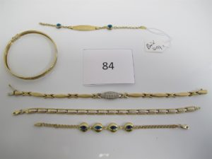 1 Bracelet ouvrant alliage 14 k(D6cm),1 bracelet articulé avec pierres blanches alliage 14 k(L20,5cm),1 bracelet alliage14 k articulé(L18,5cm),1 bracelet alliage 14k à décor d'oeils,1 bracelet alliage 14 k d'identité brisé.PB alliage14 k 25,9g.