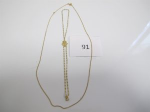 1 Chaine en or maille gourmette(L47cm),1bracelet de main en or à motif d'une main(D5cm).PB 4,6g.