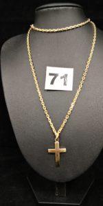 1 Chaine maille forçat ( L 60cm) et une croix demie bombée. Le tout en or. PB 19,6g