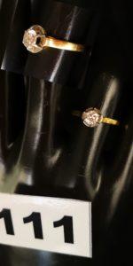 1 Solitaire en or, orné d'un diamant (TD 51). PB 2,4g