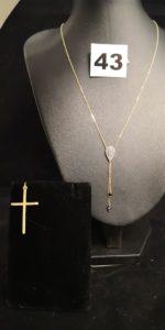 1 Collier en fine maille forçat, motif goutte et pampilles au centre (L 42cm) et une croix. Le tout en or. PB 2,6g