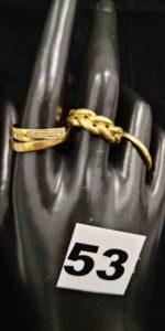 1 Bague tressée (TD 58), 1 alliance et 1 bague abimée rehaussée de petites pierres (TD 59). Le tout en or. PB 11,1g