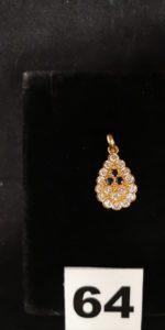 1 Pendentif en forme goutte en or orné de diamants et de pierres bleues . PB 2,1g