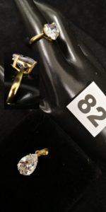 1 Bague ornée d'une pierre blanche taillée en coeur (TD 53 cabossée) et 1 pendentif en or orné d'une pierre taillée en goutte. Le tout en or. PB 5,6g