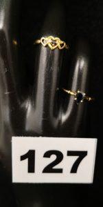 2 Bagues fines en or ornées de pierres bleues (TD 48). Le tout en or. PB 1,8g